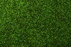 Dark green sparkling background from small sequins, closeup. Brilliant backdrop. Dark green sparkling background from small sequins, closeup. Brilliant shiny stock images