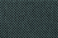 Dark green textile background with checkered pattern, closeup. Structure of the fabric macro. Dark green background with checkered pattern, closeup. Structure Stock Photos