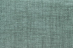 Dark green textile background with checkered pattern, closeup. Structure of the fabric macro. Dark green background with pattern, closeup. Structure of the Stock Image
