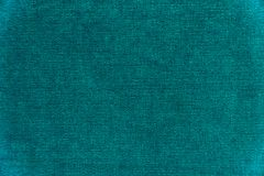 Dark green velvet texture background. Green velvet fabric Royalty Free Stock Photo
