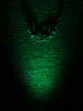 A dark green wall background with metal chains Royalty Free Stock Photography