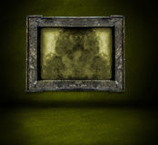 Dark green wall with frame and floor interior Royalty Free Stock Photos