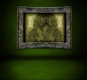 Dark green wall with frame and floor interior background Stock Photo