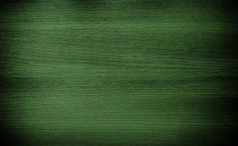 Dark green wood. Wooden tiles floor texture. Dark green wood. Natural texture background. Vignette and shadow effect.  Photo of a wooden tiles floor natural Royalty Free Stock Photo
