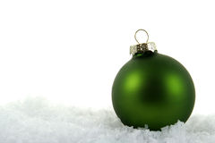 Dark Green Xmas Bauble in the Snow Stock Photography
