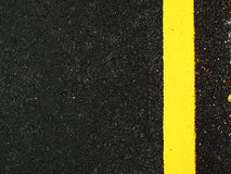 Dark grey asphalt background with yellow line Stock Photography