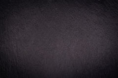 Dark grey black slate background. Or texture stock image