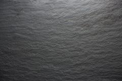 Dark grey black slate background or texture. Close up stock image