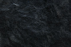 Dark grey black slate background or texture, Detailed of real genuine stone from nature. Royalty Free Stock Image