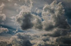 Dark grey clouds royalty free stock photography