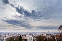 Grey clouds under big city, Paris Stock Photos