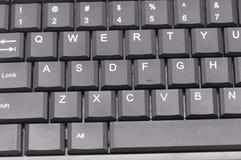Dark grey computer keyboard. A photo taken on a dark grey coloured computer keyboard Stock Photo