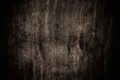 Dark grey concrete wall with imperfections and natural cement texture as scary background texture with dark vignetting. Dark grey concrete wall with stock photos