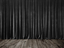 Dark grey curtains and grunge floor Stock Images