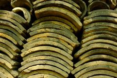 Dark grey curved roof tiles used in Buddhist temples.  Royalty Free Stock Photo