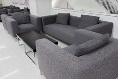 Dark grey fabric sofa in waiting room or contemporary office int Royalty Free Stock Photo