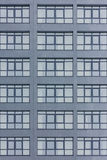 Dark grey facade of building with grey big windows. Apartment block. Family. Real estate Royalty Free Stock Photo