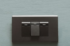 Dark grey light switch. Royalty Free Stock Photo
