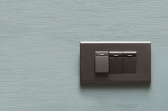 Dark grey light switch Royalty Free Stock Photos