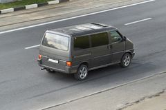 Dark grey minibus in the city rear view royalty free stock photos