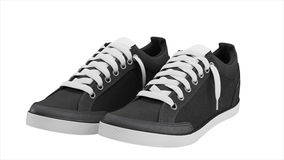 Dark grey pair of sport sneakers Stock Image