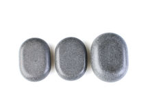 Dark Grey spa stones isolated on white Royalty Free Stock Image