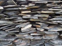 Dark grey stone layered background. Stock Photos