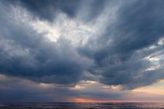 Dark, grey storm clouds above the sea. Dark, grey storm clouds above the sea stock images