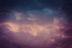 Dark Grey Storm Clouds Filtered. Dramatic stormy black sky clouds before rain, filtered natural background Stock Images