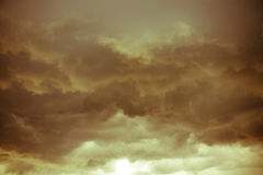 Dark Grey Storm Clouds Filtered. Dramatic stormy black sky clouds before rain, filtered natural background Stock Photo