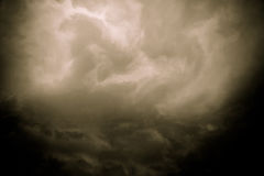 Dark Grey Storm Clouds Filtered. Dramatic stormy black sky clouds before rain, filtered natural background Stock Image