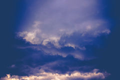 Dark Grey Stormy Clouds Filtered. Dramatic stormy dark sky clouds before rain, filtered natural background Stock Image