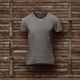 Dark grey t-shirt  on wooden background Royalty Free Stock Images