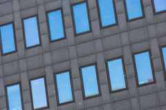 A Dark Grey tall building with reflective glass windows Royalty Free Stock Image