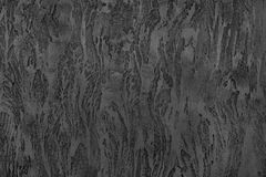 Dark grey textured surface, wall, decorative plaster. Dark grey textured surface, wall, decorative plaster royalty free stock images