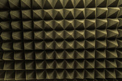 Dark grey triangular texture acoustic foam rubber. Dark grey triangular texture acoustic Stock Images