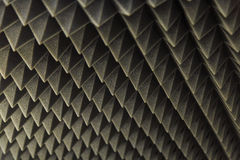 Dark grey triangular texture acoustic foam rubber. Dark grey texture acoustic foam rubber Stock Images