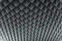 Dark grey triangular texture acoustic foam rubber. Dark grey triangular texture acoustic Stock Photography