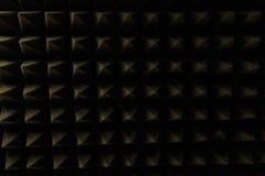 Dark grey triangular texture acoustic foam rubber. Grey triangular texture acoustic foam rubber Royalty Free Stock Images