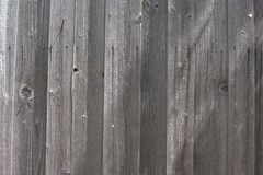 Dark grey weathered boards with visible nail rust streaks. Close up of dark gray weathered boards with various rusty nails and the rust streaks that originate Stock Photo