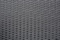 Dark grey weave plastic texture royalty free stock photography