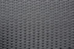 Dark grey weave plastic texture royalty free stock photography