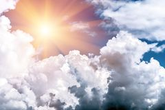 Dark, grey and white storm clouds and sun. Before rain, nature background royalty free stock photo