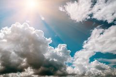 Dark, grey and white storm clouds and sun. Before rain, nature background stock photos