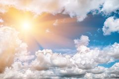 Dark, grey and white storm clouds and sun. Before rain, nature background stock images