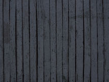 Dark grey wooden fence background Royalty Free Stock Image