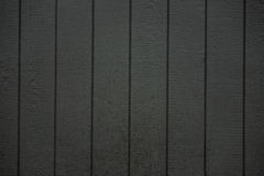 Dark grey wooden fence background texture Stock Photo