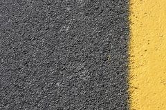 Dark grey with yellow asphalt road background. Background in dark grey with yellow paint Royalty Free Stock Images
