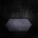 Dark grunge background with cutout showing perforated metal Royalty Free Stock Image