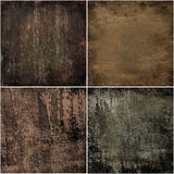 Dark grunge backgrounds. Four dark backgrounds in grunge style royalty free illustration
